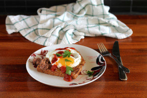 toast for dinner - refried beans, fried egg, and salsa